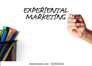 EXPERIENTIAL MARKETING - words on the whiteboard. business concept of hand holding pen with baskets filled pen.