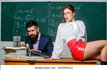 Experimenting with feelings. Attractive teacher latex skirt. Cheeky teacher. Impudent student. Flirting colleague. Lustful tutor. Girl sexy buttocks sit table. Everyone dreaming about such teacher.