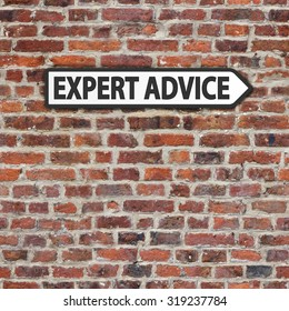 Expert advice black and white sign on brick wall background