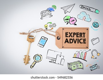 Expert Advice. Key and a note on a white background