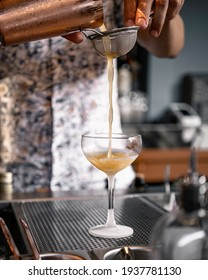 Expert barman is making cocktail