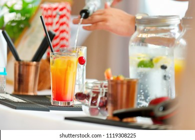Expert barman making cocktail at event or wedding reception