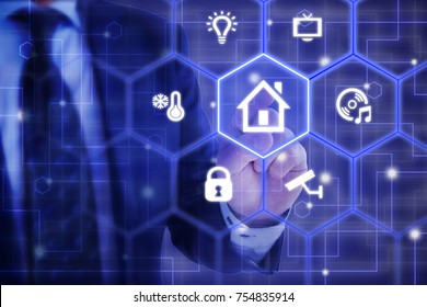 IT expert in a blue suit touches a hexagon tile  with a house icon surrounded by smart home symbols