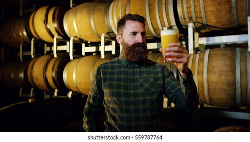 expert brewer of beer tastes in style hipster uan clear double malt beer. concept of craft beer and plenty of hops.