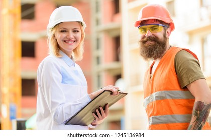 Expert and builder communicate about supply building materials. Successful deal concept. Purchase of building materials. Construction industry. Foreman established supply of building materials.