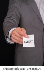 Expert, businessman Giving a Business Card. Business meeting, negotiations, partnership concept