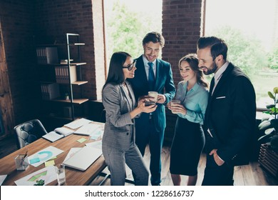 Expert collar occupation analyst manager accountant secretary person stand inside loft interior chill after seminar look at cellular make toothy smile hold beverage drink cup mug coffee tea in hands