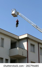 expert firefighter down with the rope in the building during a fire alarm in the fire station