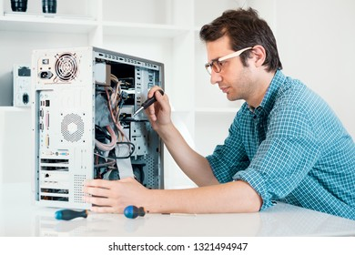 Expert man assembling pc and checking for problem
