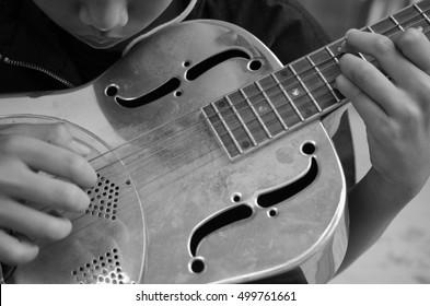 Expert Musician plays a Dobro Guitar,Classic Dobro guitar played my a master