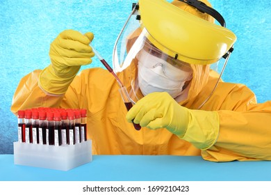 An expert in protective suit doing coronavirus research with a test tube in hand