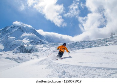 Expert skier enjoying fantastic conditions on the  glaciers of Monte Rosa
