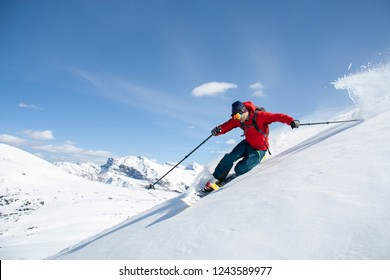 Expert skier skiing in the backcountry