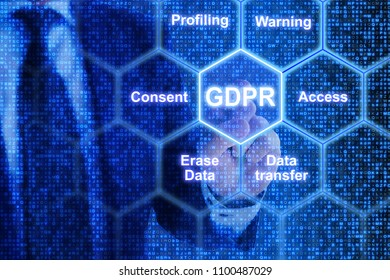 IT expert touching a tile in a hexagon grid with GDPR keywords