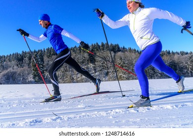 experts doing cc-skiing in winter