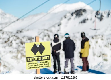 A experts only sign indicating a double black diamond run on the top of Blackcomb mountain.