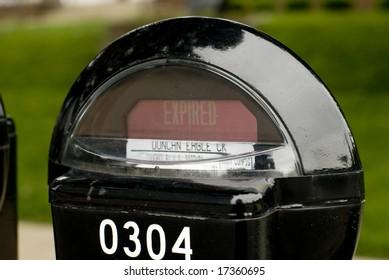 An expired black parking meter