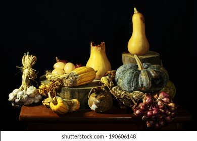 Expired pumpkins with garlic eggs as still life art photography