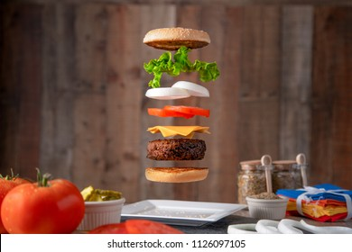 Exploded view of a cheeseburger with fresh ingredients. Levitating Cheeseburger.
