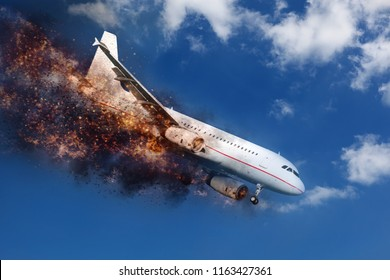 exploding and  burning white aircraft in the blue sky before crashing down