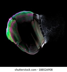 Exploding Soap Bubble in colorful colors on black background