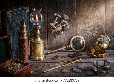 Exploration and nautical theme grunge background. Compass, telescope, sextant, coin, divider and old book on wood desk.