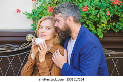 Explore cafe and public places. Couple cuddling cafe terrace. Couple in love sit cafe terrace enjoy coffee. Pleasant family weekend. Married lovely couple relaxing together. Travel and vacation.