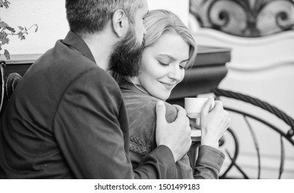 Explore cafe and public places. Married lovely couple relaxing together. Happy together. Couple cuddling cafe terrace. Couple in love sit hug cafe terrace enjoy coffee. Pleasant family weekend.