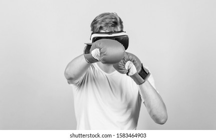 Explore cyber space. Cyber sportsman boxing gloves. Augmented 3D world. Man boxer virtual reality headset simulation. Man play game in VR glasses. Cyber sport concept. Cyber coach online training.