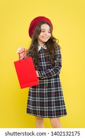 Explore fashion industry. Shopping and purchase. Black friday. Sale discount. Shopping day. Child hold package. Kids fashion. Birthday girl. Favorite brands and hottest trends. Girl with shopping bag.