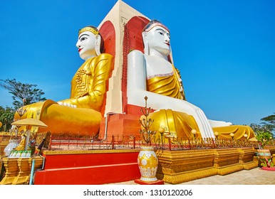 Explore the giant Buddha images in mudra (gesture) Earth Witness (Touching Earth) in Kyaik Pun Pagoda, famous for four statues of Buddha, that riched Nirvana, Bago, Myanmar.