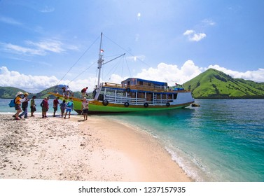 Explore Komodo island. Tourists on vacation to explore over sea the komodo island  using ''phinisi'' traditional ships. Kelor Island, Komodo National park, Flores, Indonesia. Friday (6 January 2017).