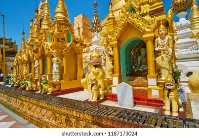 Explore the small outer stupas of Shwedagon Zedi Daw with Nat statues and mythic creatures-guards around the images of Buddha, Yangon, Myanmar.