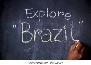 Explore word written on blackboard with chalk. Concept is to discover a new country. This photo may use as travel and living background.