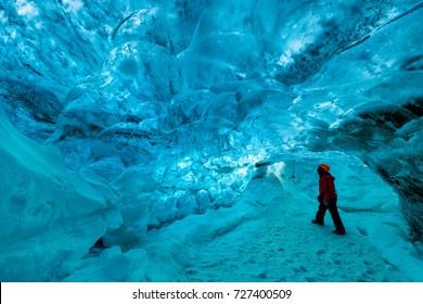 explorer inside an ice cave, Skaftafell glacier, vatnajokull national park, Iceland