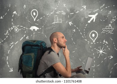 Explorer plans a new travel with his laptop