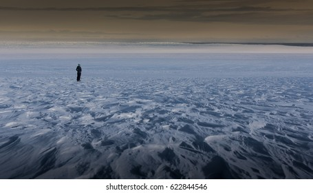 Explorer Standing in Antarctic Wilderness