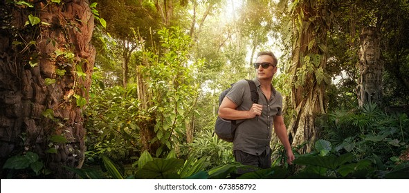 explorer- tourist with backpack studies ancient ruins in the Central America wild jungles.Concept travel and adventure.