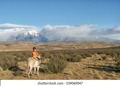 Explorer travel to Tores Del Pine by riding horse in Patagonia -Chile