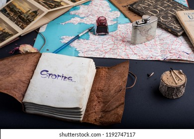 Explorers notes with a flap and matches and ink pen on a map