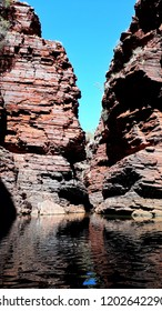 Exploring the ancient geological stone formations of the Karijini National Park and enjoying the beautiful scenery in Western Australia