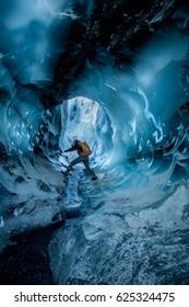 Exploring glacier caves in Alaska