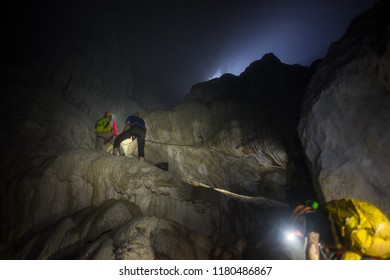 Exploring people going down to deep cave by rope in Son Doong Cave, the largest cave in the world in UNESCO World Heritage Site Phong Nha-Ke Bang National Park, Quang Binh province, Vietnam