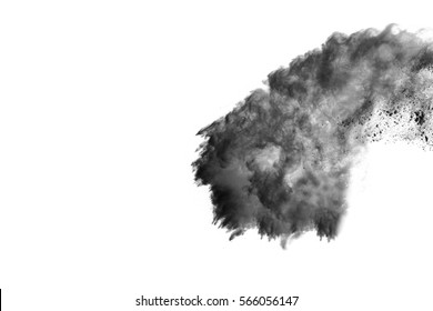 Explosion of black powder on white background