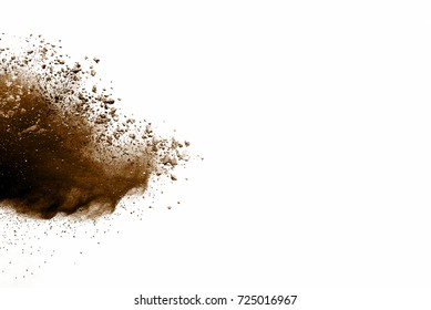 Explosion of brown dust on white background. Dry soil explosion on white background.