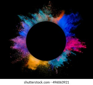 Explosion of colored powder with copyspace inside, isolated on black background