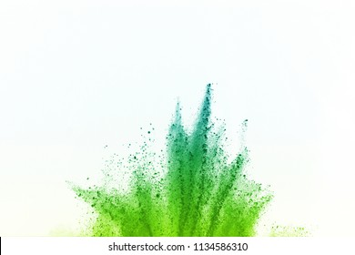 Explosion of colored powder isolated on white background. Green Powder or clouds splatted.