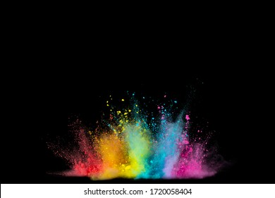 Explosion of colored powder isolated on black background. Abstract colored background