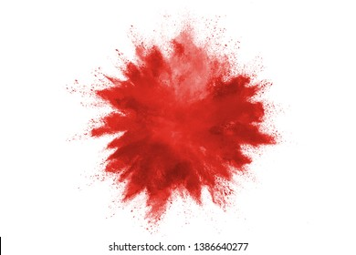 Explosion of colored powder on white background. Red dust explode.