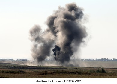 The explosion of a combat charge at the site during the battle, military action, the conflict between Ukraine and Donbass